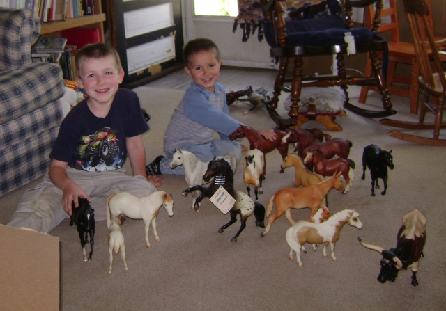 Colton and Alex enjoying Kyle and My collection of Breyer Horses